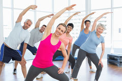 Class stretching hands at yoga class Royalty Free Stock Images