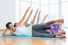 Class stretching legs and hands in row at yoga class Stock Photos