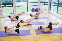 Class stretching on mats at yoga class Royalty Free Stock Images
