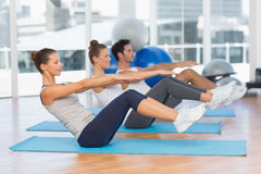 Class stretching on mats at yoga class Royalty Free Stock Image