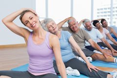 Class stretching neck in row at yoga class Stock Images