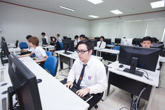 A class of students in front of their screens study computer science. Royalty Free Stock Photos