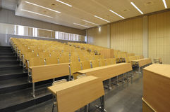 Class university and sloping wooden tables. Class university with empty wooden tables stock photos