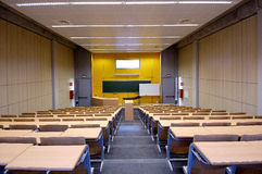 Class university and sloping wooden tables Royalty Free Stock Images