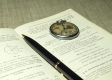 Classbook, pen and old watches Royalty Free Stock Images