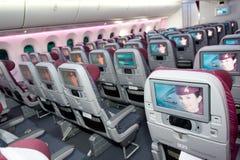 Classe de economia de Qatar Airways em Singapura Airshow 2014 Fotos de Stock Royalty Free