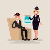 Classe executiva A comissária de bordo traz a homem de negócios o vidro de c Foto de Stock