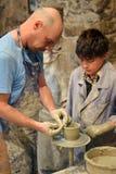 Classe mestra no castelo de Kamenetz-Podolsk da cerâmica 1º de maio de 2012 dentro, Fotos de Stock