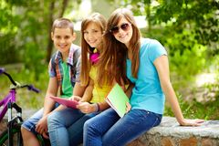 After classes. Three friends enjoying their free time after school classes royalty free stock photography