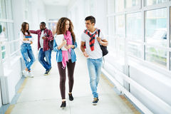 After classes. Two students walking down college corridor after classes stock image