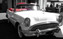 Classic 1950's Car. In black and white with red seats Royalty Free Stock Photo