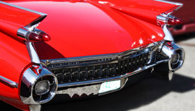 Classic 1950s Car. Rear end of classic red 1950s car with rocket tail lights Stock Photo