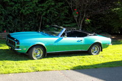 Classic 1968 Chevy Camaro Convertible Rally Sport. A classic bluegreen 1968 Chevrolet Camaro Rally Sport Convertible with black front end stripe.  Top down view Stock Photos
