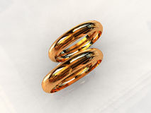 Classic 24ct gold wedding rings. 3D render Royalty Free Stock Image