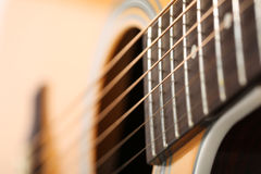 Classic acoustic guitar at weird and unusual perspective Stock Photos