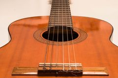 Classic acoustic guitar on white background view royalty free stock photos