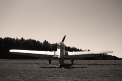 Classic airplane of WWII. On a airfield in sepia colors stock image