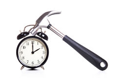 Classic alarm clock and hammer Royalty Free Stock Photography