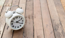 Classic alarm clock on wood Royalty Free Stock Photos