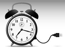 Classic alarmclock with USB cable Stock Photography