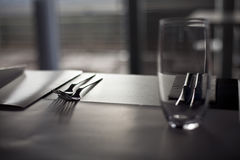 Classic ambient for banqueting. Glass and cutlery on the table Stock Photos