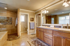 Classic American bathroom with wooden cabinets, two white sinks Stock Image