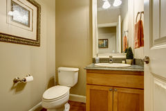 Classic american bathtub with tile floor and wooden cabinets Royalty Free Stock Photo