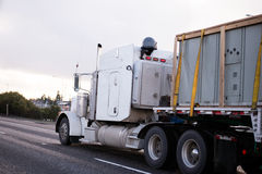 Classic American big rig semi truck with flat bed trailer Royalty Free Stock Photography