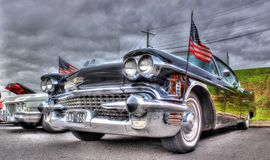 Classic American black Cadillac and flags Royalty Free Stock Images