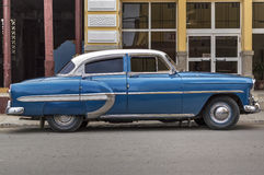 Classic american blue car in Guantanamo, Cuba. An old american car parked in the main street of Guanatanamo City, Cuba royalty free stock image