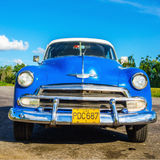 Classic American blue car in Havana, Cuba Stock Photos