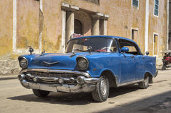 Classic american blue car in Old Havana, Cuba. An old american car passing in front of a convent in Old Havana, Cuba royalty free stock photography
