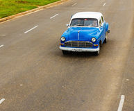 Classic American blue car one of streets in Havana, Cuba Stock Photo