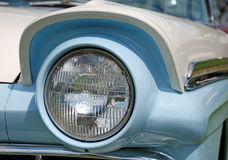 Classic American Car. A headlight detail of a baby blue and white classic american car Royalty Free Stock Photo