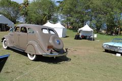 Classic desoto driven on field. Classic American car being driven on field. 1935 Desoto Airflow. Boca Raton Resort Club, south Florida Stock Image