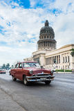 Classic american car and Capitolio landmark in Havana,Cuba Royalty Free Stock Photography