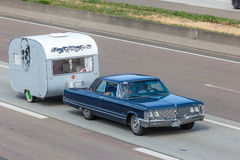 Classic American Car with a caravan Royalty Free Stock Photos