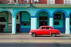 Classic american car in downtown Havana. Classic american car in a colorful street in downtown Havana Royalty Free Stock Image