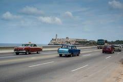 Classic american car drive on street in Havana,Cuba. Havana, Cuba - September 28, 2015: Classic american car drive  on Malecon sea front promenade in Havana,Cuba Royalty Free Stock Photo