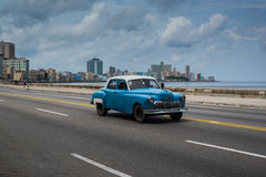 Classic american car drive on street in Havana,Cuba. Havana, Cuba - September 28, 2015: Classic american car drive on Malecon sea front promenade in Havana,Cuba Stock Images