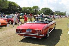 Classic american car driving away Royalty Free Stock Photos