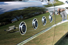 Classic american car fender detail. Classic luxury American car rear front fender detail, portholes close up, shallow depth of field. 1955 buick roadmaster royalty free stock photos
