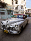 Classic american car in Old Havana. Classic DeSoto in a shabby neighborhood in Old Havana .Before a new law issued on October 2011,cubans could only trade cars Royalty Free Stock Photography