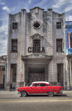 Classic american car in Old Havana, Cuba. Red vintage car in front of a colonial building in Old Havana, Cuba stock photography