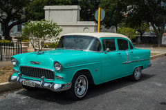 Classic american car park on street in Havana,Cuba. Havana, Cuba - September 28, 2015: Classic american car park on street of Old Havana,Cuba. Classic American Stock Photo