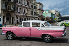Classic american car park on street in Havana,Cuba. Havana, Cuba - September 28, 2015: Classic american car park on street of Old Havana,Cuba. Classic American Royalty Free Stock Photo