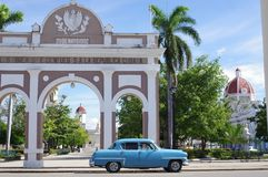 Classic American car parked in front of Arc. Classic old American car parked in front of Arc of Triumph at Marti Park in Cienfuegos in Cuba Stock Image