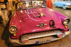 Classic American car with a picture of Che Guevara on the street of Havana, Cuba. This is taxi cab, popular among tourists in historic centre. It is pink and royalty free stock image