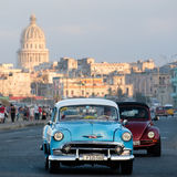 Classic american car rides along the seaside Malecon avenue in Havana. HAVANA,CUBA - FEBRUARY 24, 2017 : A classic american car rides along the seaside Malecon Stock Photography