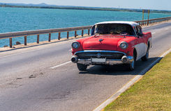 Classic American car on a seaside highway Royalty Free Stock Image